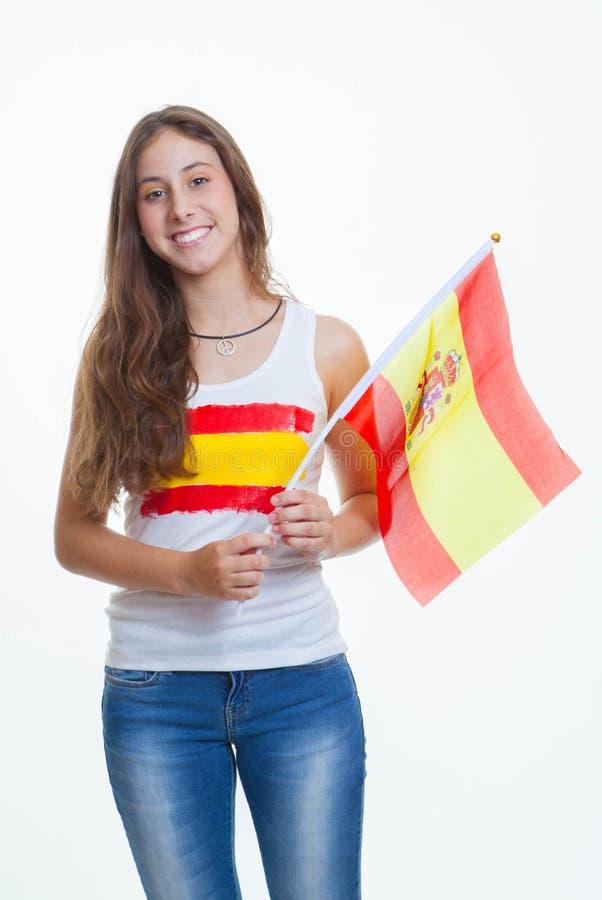 Spanish flag person. Patriotic spanish teen waving flag stock photo