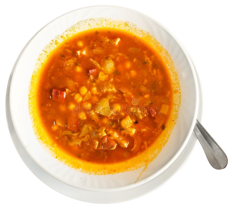 Spanish food callos with chickpeas, pepper and beef tripe, nobody. Spanish food callos with chickpeas, pepper and beef tripe, served in bowl. Isolated over white stock photo