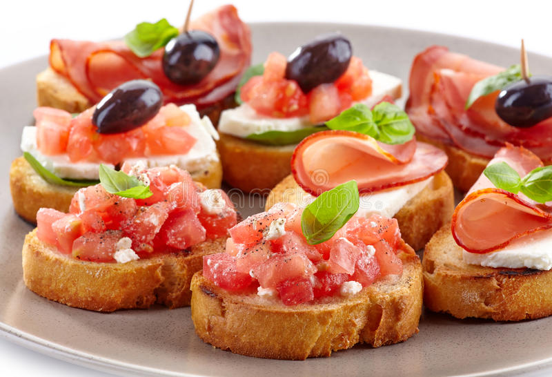 Spanish food tapas. Toasted bread with tomato and ham stock photo
