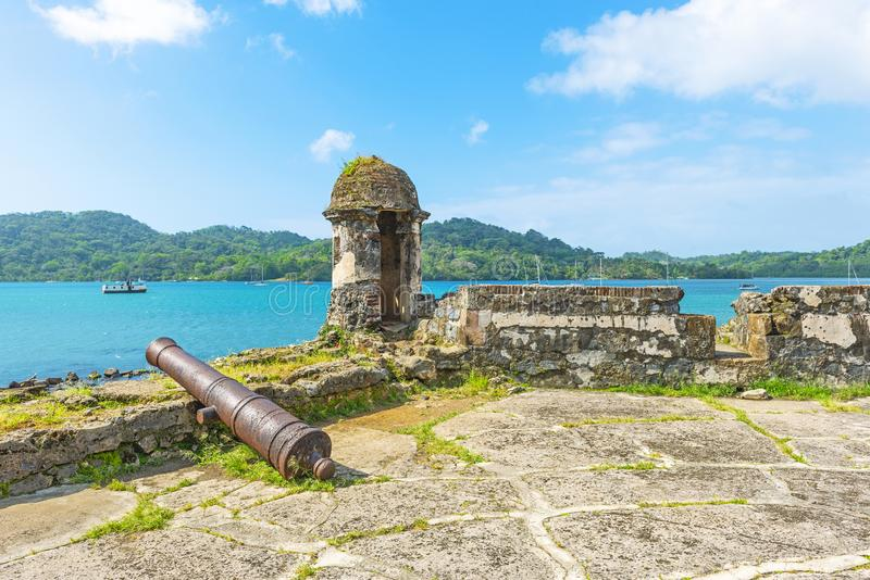 Spanish Fort in Portobelo, Panama. Ancient Spanish fortress with shooting tower and cannon by the Caribbean Sea to protect the custom from pirate attacks royalty free stock photography