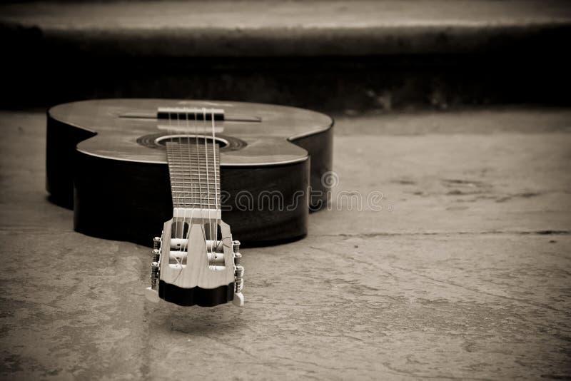 Spanish guitar in sepia stock image