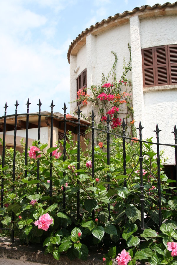 Spanish house with flowers royalty free stock images