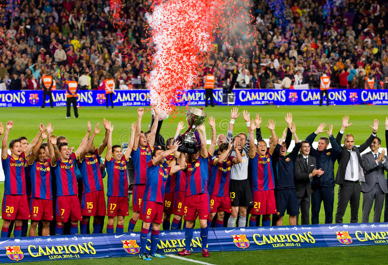 Spanish League Champions 2010-2011. BARCELONA - MAY 15: FC Barcelona players receiving the cup and celebrating the Spanish League Championship victory in Camp stock image