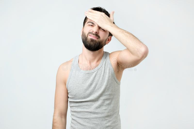 Spanish man putting his hand on the forehead remembering something important royalty free stock photography