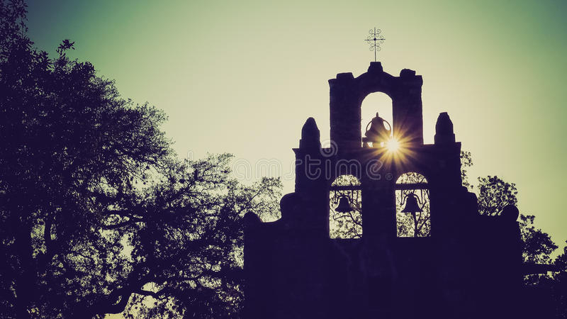 Spanish Mission Espada Church Bells in San Antonio, Texas. Spanish Mission Espada church bells in silhouette as the sun sets behind mission in San Antonio, Texas stock images