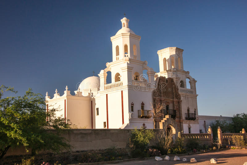 Spanish Mission Near Sunset. The meticulously restored mission of San Xavier stands in contrast with the deep blue sky royalty free stock photography