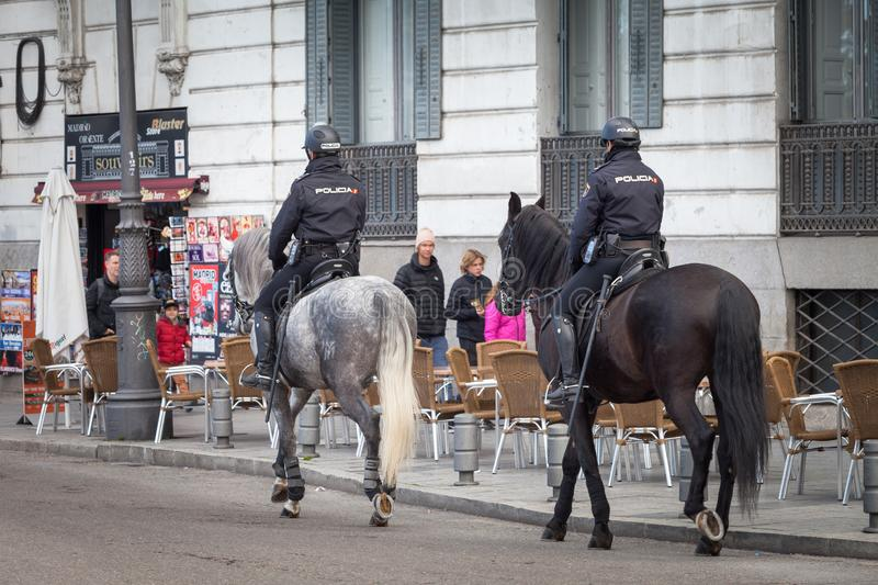 Spanish mounted police officer in Madrid, behind Royal Palace. Madrid, Spain, February 12, 2018: Spanish mounted police officer in Madrid, behind Royal Palace royalty free stock images