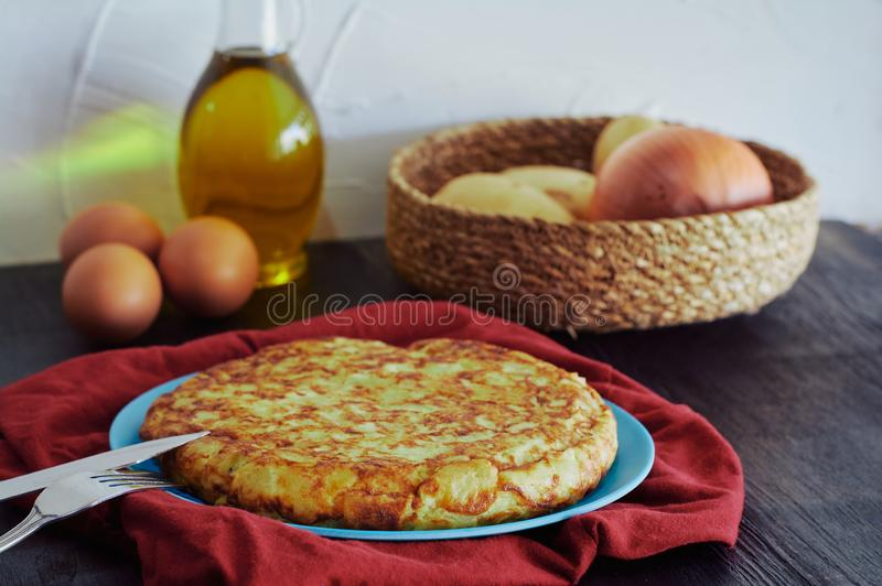 Spanish omelette with potato, egg and onion, accompanied by olive oil royalty free stock photo