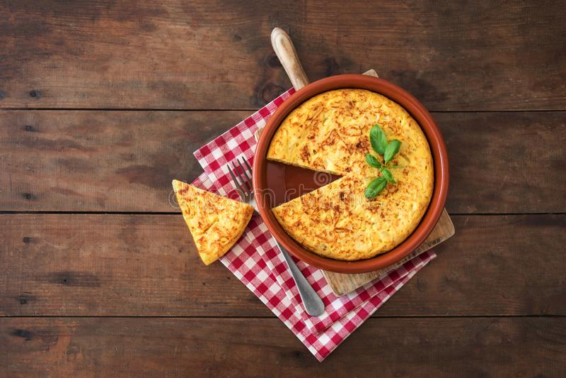 Spanish potato omelet called tortilla de patatas on a rustic woo royalty free stock photos