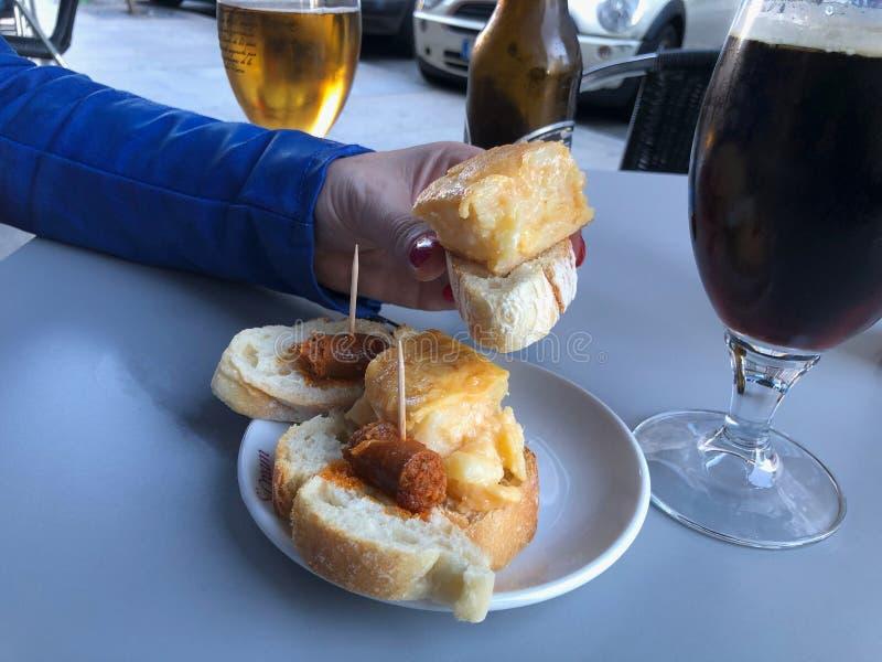 Spanish potato omelette with chorizo top stock photography