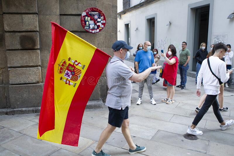 Spanish protester with face mask protesting touching a saucepan against the management of the government of Spain during the covid royalty free stock photo