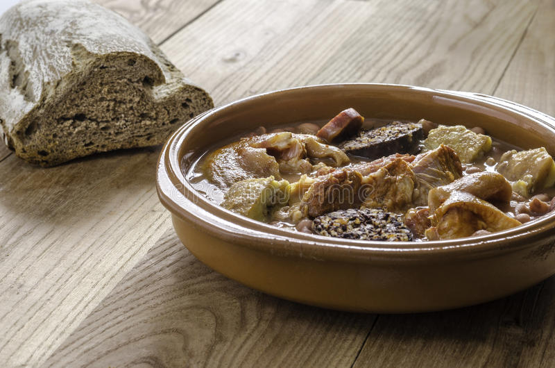 Spanish red bean stew with eartheOlla podrida, spanish red bean stew with chorizo, pig and blood sausage with earthnware casserole. Spanish red bean stew with royalty free stock photos