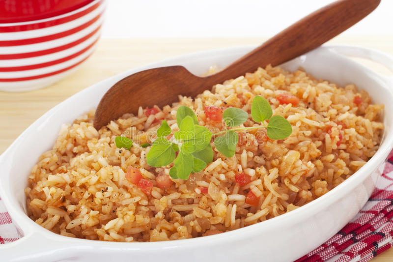 Spanish Rice. A serving bowl full of Spanish rice, a perfect accompaniment for chili. It's flavoured with onion, garlic, chicken stock, tomato and oregano stock photography
