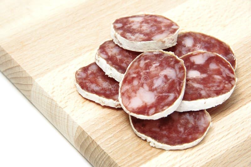 Spanish salami. Red spanish salami on a white background royalty free stock photo