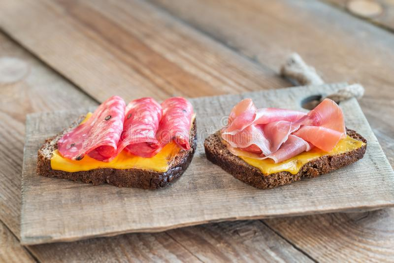 Spanish sandwiches with salchichon anb jamon royalty free stock photography