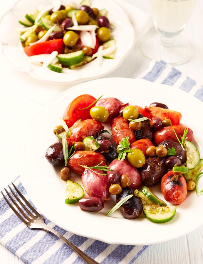 spanish sausage with tomatoes cucumber and different marinated