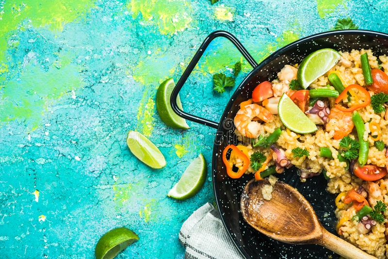 Spanish seafood paella made for sharing with friends stock image