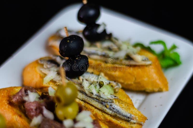 Spanish seafood tapas, mini sandwiches food set, delicious snac royalty free stock photo