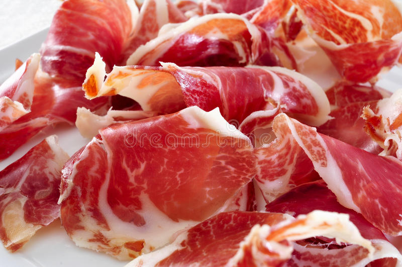 Spanish serrano. Closeup of a plate with spanish serrano ham stock images