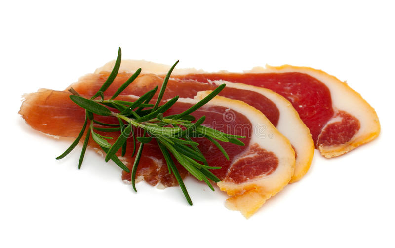 Spanish serrano ham. Isolated on white stock image