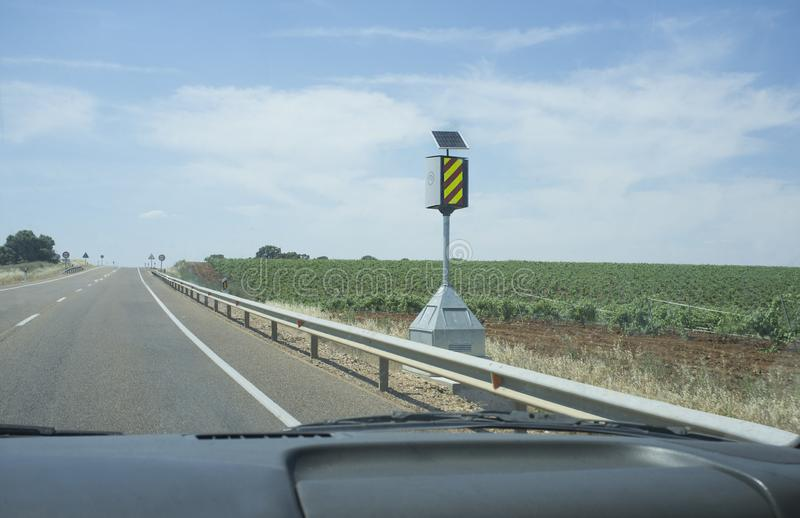 Spanish speed control pole device at country road royalty free stock image