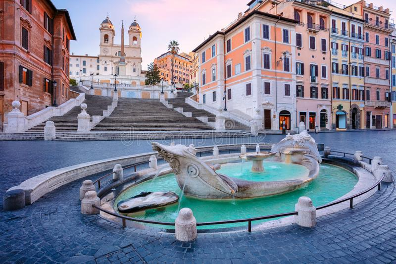 Spanish Steps, Rome. Cityscape image of Spanish Steps and Barcaccia Fountain in Rome, Italy during sunrise royalty free stock images