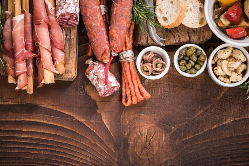 Spanish tapas bar food border background. On wooden rustic table stock image