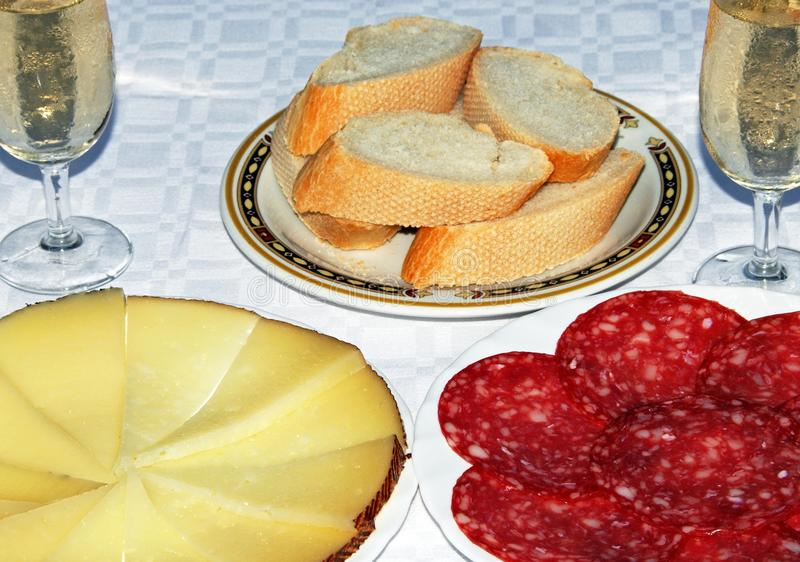 Spanish tapas and sherry. Spanish tapas of Manchego cheese and salami with two glasses of fino sherry, Andalusia, Spain royalty free stock image