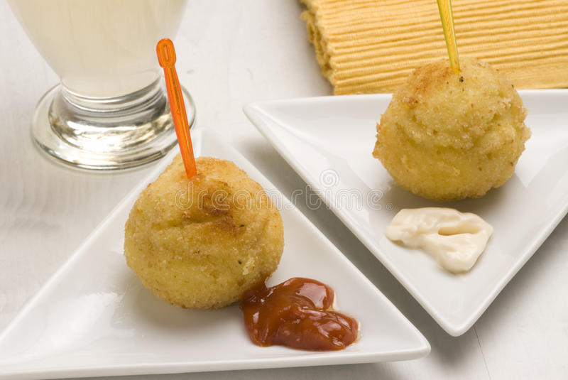 Spanish tapas. Potato fritters. Bombas picantes. stock photo