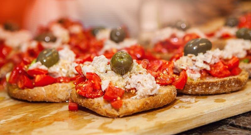 Spanish tapas with tuna. Tasty Spanish tapas with tuna, tomato and olives royalty free stock image