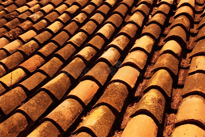 Spanish Terra Cotta. Antique terra cotta roof tiles on Andalusian buildings at Granada's La Alhambra endure and last through the ages. Macro royalty free stock photo