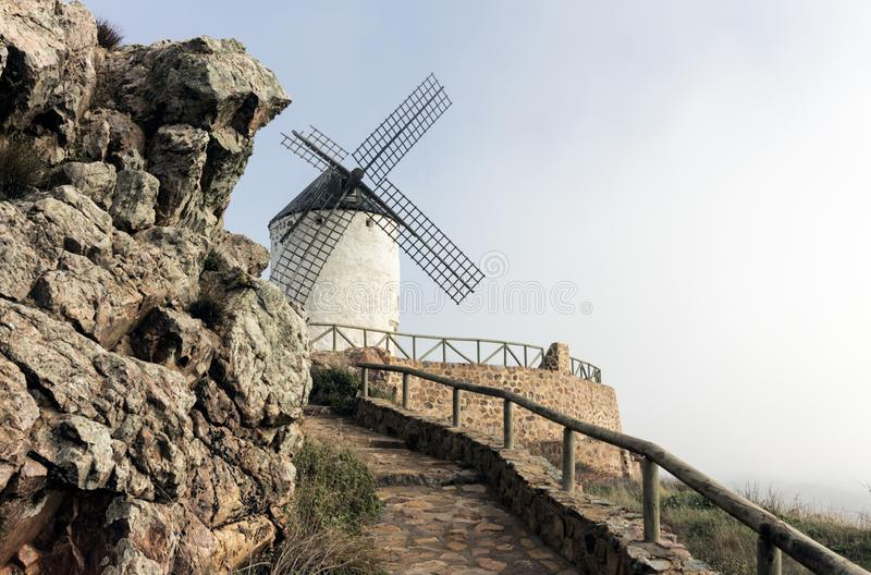 Spanish windmill at the end of the road stock image