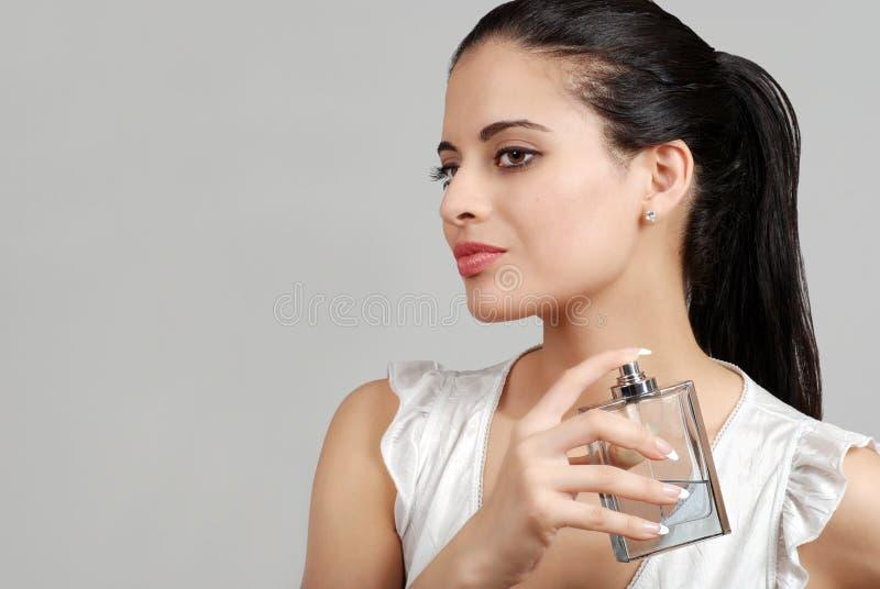 Download Spanish Woman Spraying Perfume Stock Image - Image: 13809537