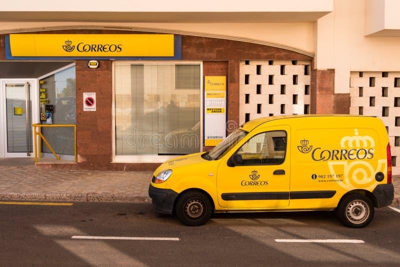 Spanjorstolpe - kontor och leveransskåpbil arkivfoto