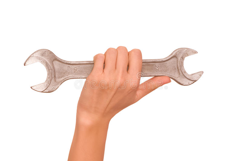 Spanner. In the woman's hand royalty free stock photography