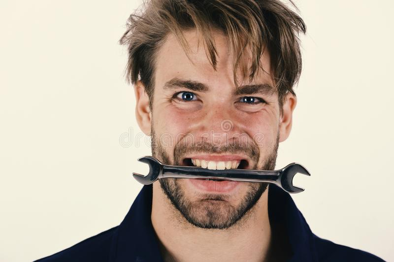 Spanner instrument for fixing or tightening details. Man holds wrench royalty free stock photography