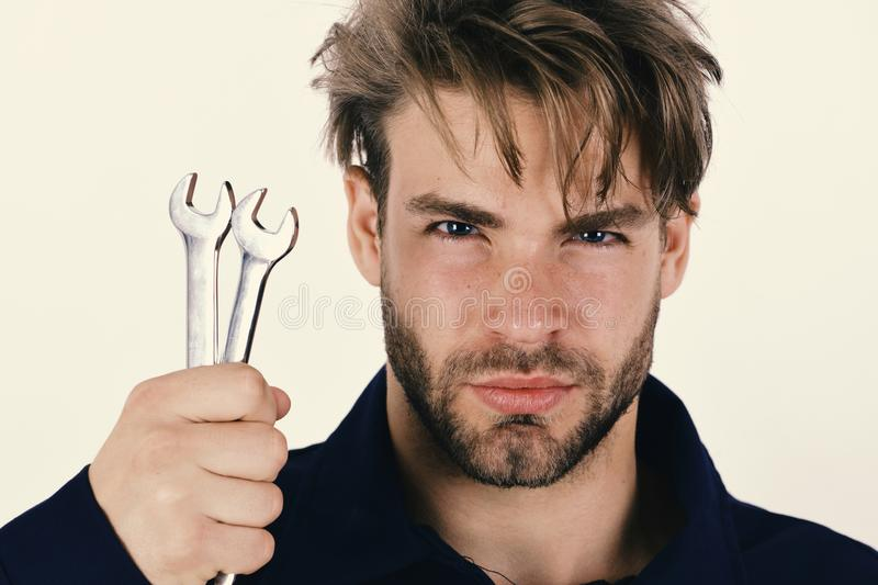 Spanner instrument for fixing or tightening details. Mechanic or plumber with metallic spanner in hand. stock photos