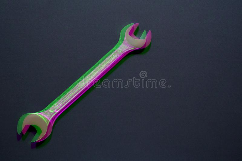 Spanner wrench on black background, Open box wrench chrome engineering instrument. Digital signal  glitch effect rgb shift, slice stock photography