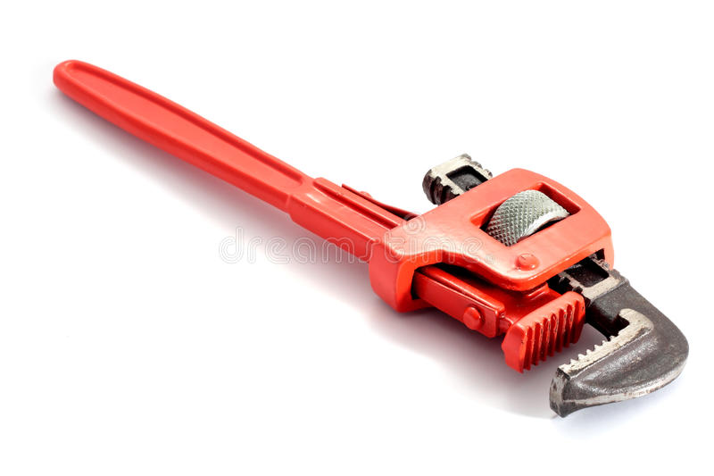 Spanner wrench plumbing. Adjustable spanner colored red for plumbing isolated on fund in horizontal royalty free stock photography