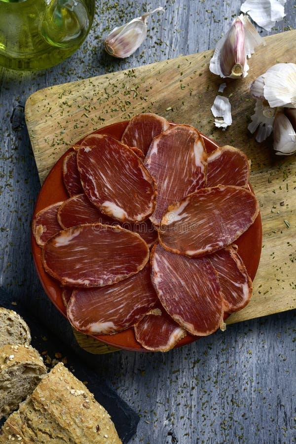 Spansk lomoembuchado, kurerad grisköttfläskkarré royaltyfri fotografi