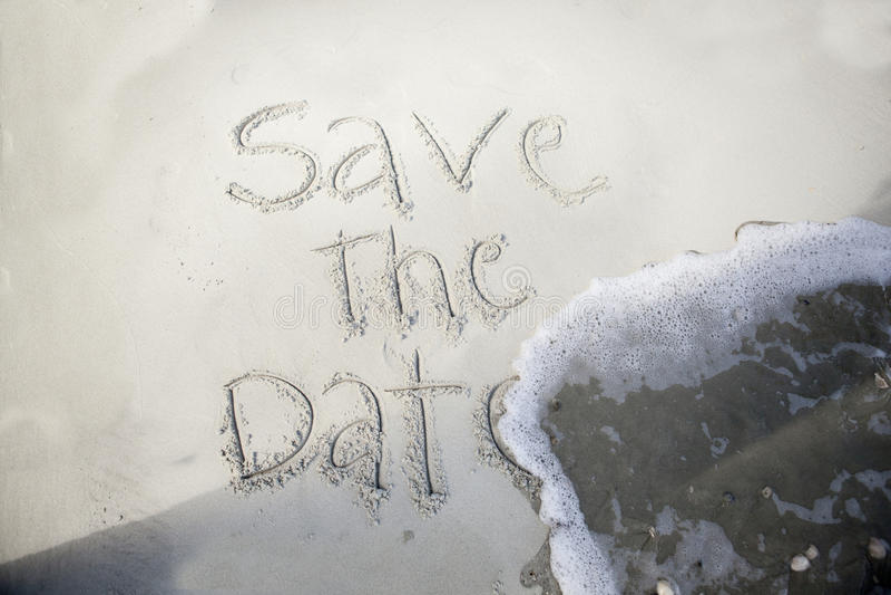 Spara datumet, i sand arkivbilder
