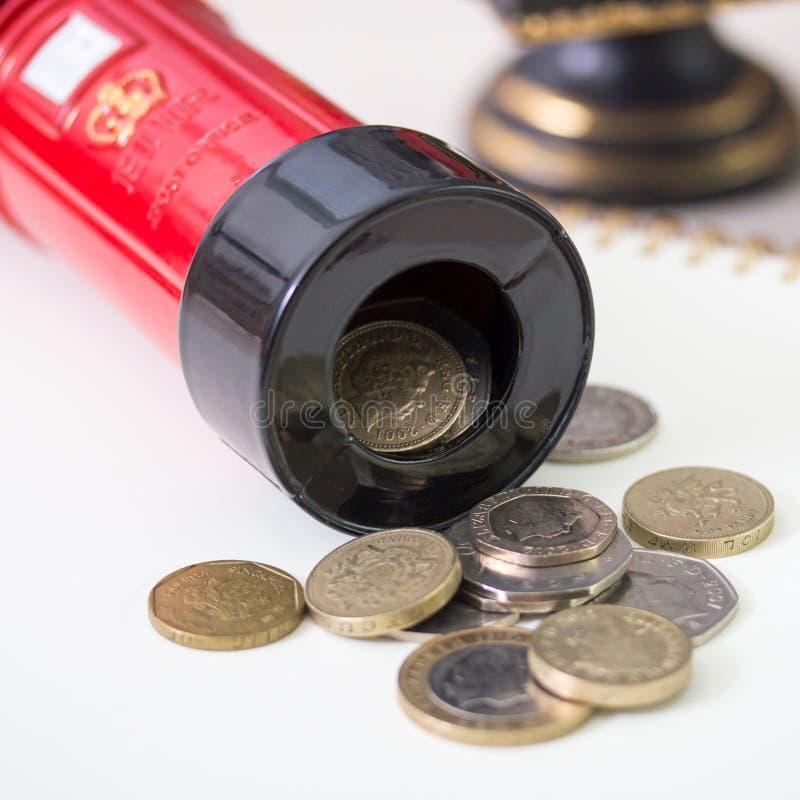 Sparande av dina pengar med gyckel royaltyfri fotografi