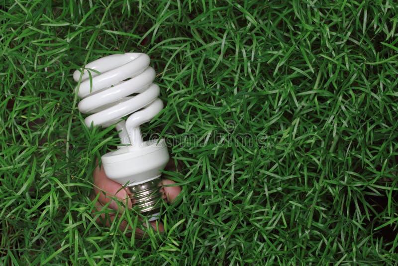 sparande för lampa för kulaenergihand arkivfoton