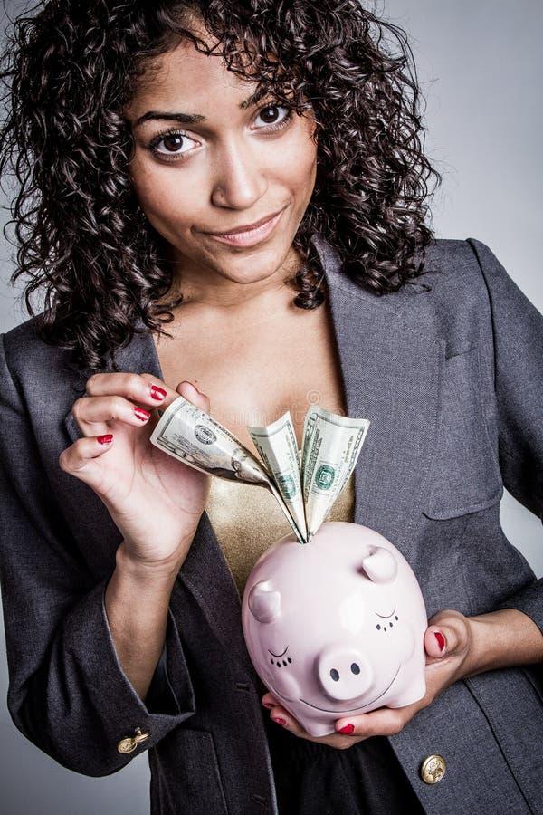 Sparande pengar för kvinna royaltyfria foton