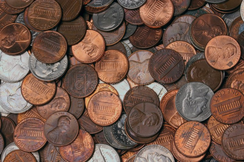 Spare Change. Pocket, Change, background, wallpaper, coins, money, currency, penny, dine, nickle, quarter, spare royalty free stock image