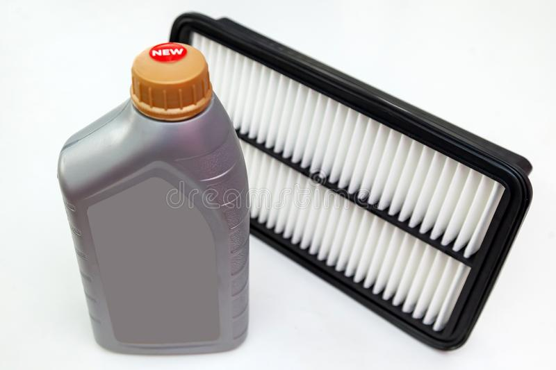 Spare part for car engine air filter for cleaning dust and dirt with bottle on a white isolated background. Maintenance and oil royalty free stock photography