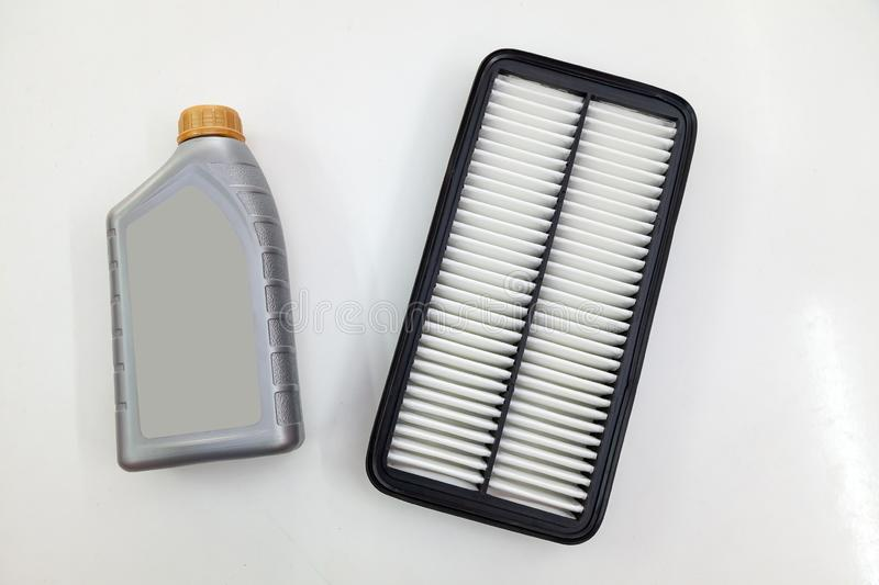 Spare part for car engine air filter for cleaning dust and dirt with bottle on a white isolated background. Maintenance and oil stock photos