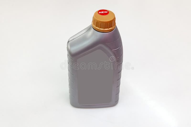 Spare part for car engine oil one liter bottle on a white  background. Maintenance and oil change in auto service royalty free stock photos
