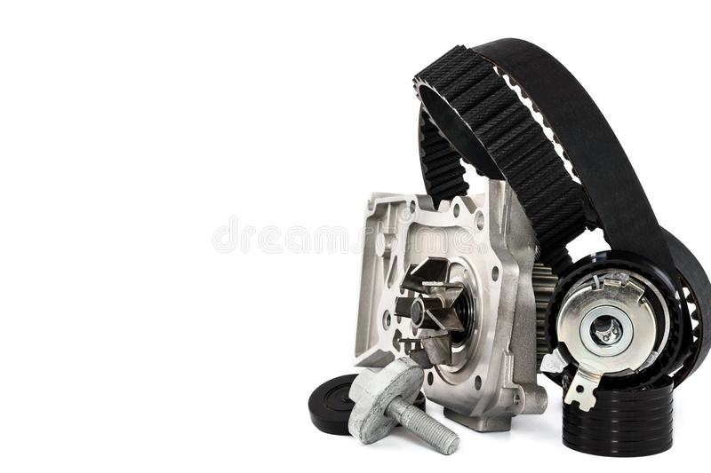 Kit of timing belt with rollers and pump on a white background. Spare parts for the car. The set of timing belt with rollers and cooling pump on a white stock photography