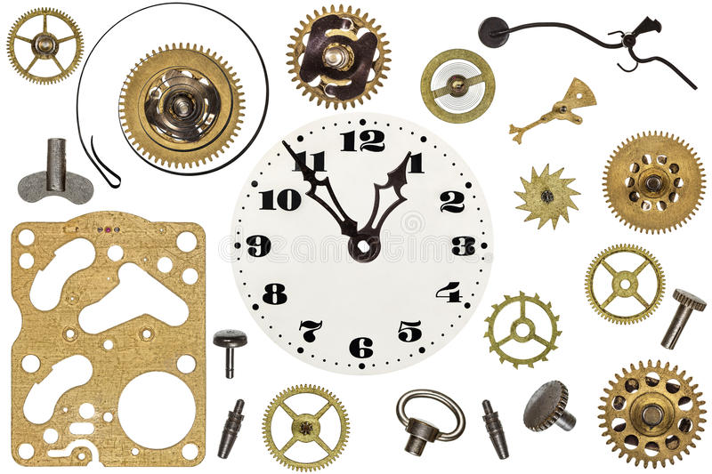 Spare parts for clock. Metal gears, cogwheels and other details stock photography